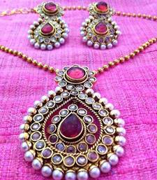 Buy Charming rani or dark pink pearl pokli pendant set with beautiful pendant & earrings which can also be worn alone v162r Pendant online