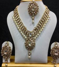 Buy Dazzling Kundan Set in White with Pearls necklace-set online