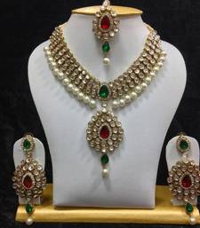 Buy Dazzling kundan set in Red and Green Stones and Pearls necklace-set online