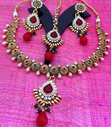 Buy Rope coil motif in red green stones south indian temple collection pearl polki necklace set j27rg Necklace online