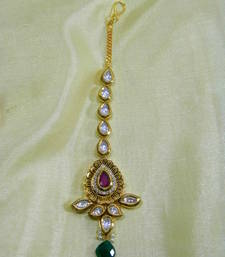 Buy Pretty Maang Tika made of Original Kundan, American Diamond and Pink Ruby  maang-tikka online