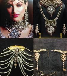 Buy Kanishka Bridal Kundan Jewelry Set in Maroon with Pearls bridal-set online