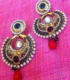 Buy Maroon stones with green stones at the base pearl polki earring th18mg gifts-for-sister online