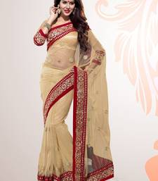 Buy Beige Embroidered Net Party Wear Saree With Blouse supernet-saree online