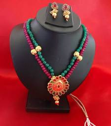 Buy Pink  & Green Temple Pendant with small dual Onyx Stone strings with earrings Pendant online
