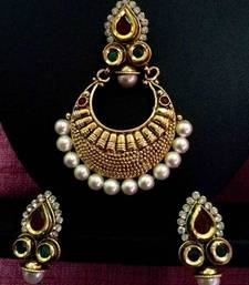 Buy Colourful stylish kundan work & ethnic golden base maroon green pearl polki pendant set ab23mg Pendant online
