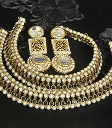 Buy Gold Plated Handcrafted White colour Earrings & Black colour Anklets with Pearl jewellery-combo online