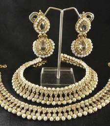 Buy White colour Pearl Anklets & White colour Earrings jewellery-combo online