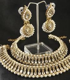 Buy Kundan Pearl Anklets & White colour Earrings jewellery-combo online