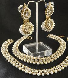 Buy Pearl Anklets & White colour Earrings jewellery-combo online