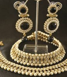 Buy White colour Pearl Anklets & Black colour Pearl Earrings jewellery-combo online