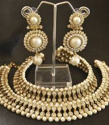 Buy White colour Pearl Anklets & Pearl Earrings jewellery-combo online