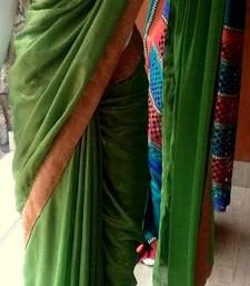 Buy Green self patterned shimmer gorgette saree and golden self designed border with brocade blouse shimmer-saree online