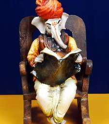 Buy Ganpatiji on a Wooden Chair Reading News Paper ganesh-chaturthi-gift online